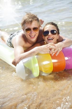 couple having fun on a lilo