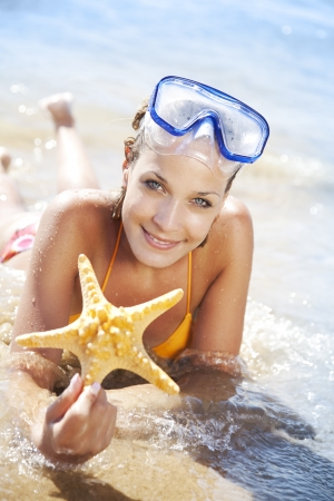 female with starfish in her hand