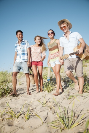 candid: group of young people camping or going on a day trip  Stock Photo