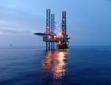 Offshore oil rig before sunrise photo