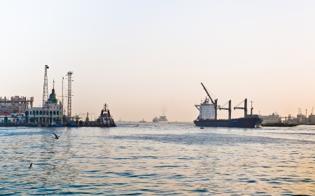 canals: Vessel of first convoy passing Port Said in Suez canal