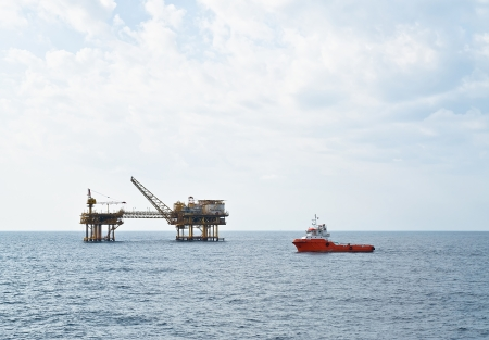 oil platform: Stand-by boat carrying out the duty Stock Photo
