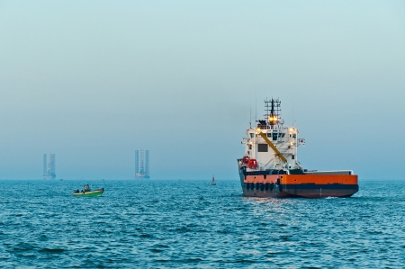 Offshore supply vessel sailing out from Abu Qir port photo