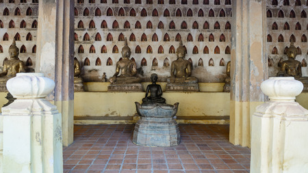 corridors: Ancient Buddha In the corridors around Pha That Luang, Vientiane Stock Photo