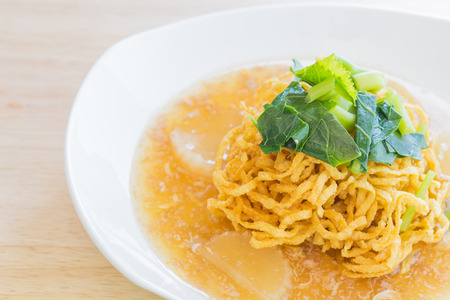 fried noodle: Fried noodle with pork on tableware. Stock Photo