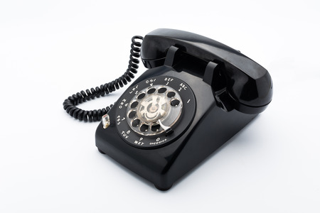 dialplate: Black old telephon with rotary dial on white background