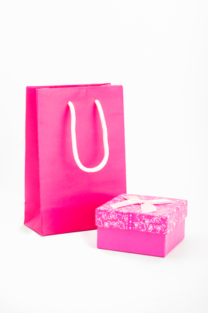 life event: Shopping bags placed pink with pink gift box on white background