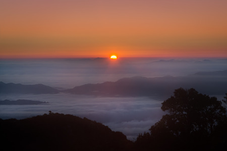Mountain Mist in sunrise at  doi luang chiang dao in Chiang mai province Thailand. Stock Photo