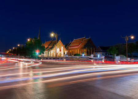 Chang Kham temple in twilight scene with light trails from long exposure.