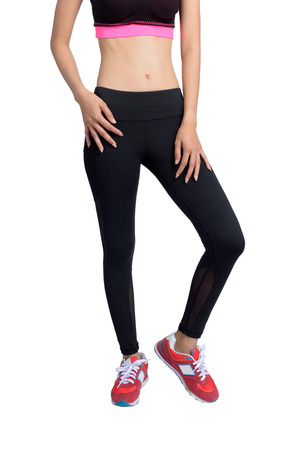 Women s black fitness pant and red sport shoes isolated on white background with clipping path.