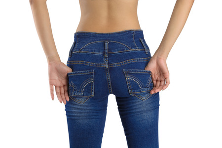 Hip women's contour. Wearing tight jeans isolated on white background with clipping path., Rear view.