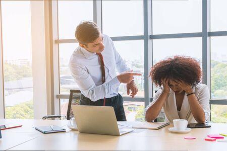 Businessman as boss blaming of admonish his woman employee african american.