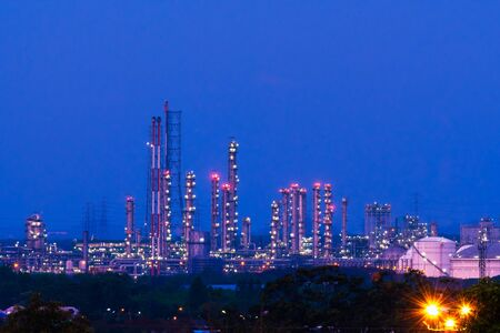 factory Petrochemical, petroleum refining plant at twilight time.