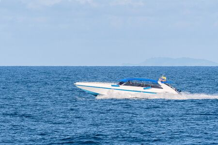 Speed boat on azure sea in turquoise blue water. Stock Photo
