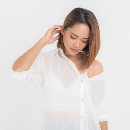 Beautiful portrait asian woman brown short bob wearing a white shirt on isolated white background. In close-up view, Sexy moment