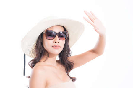 Close-up, Beautiful woman portrait face in sun hat and sunglasses enjoying with sun at studio shot isolated on white background. Sun protection concept.