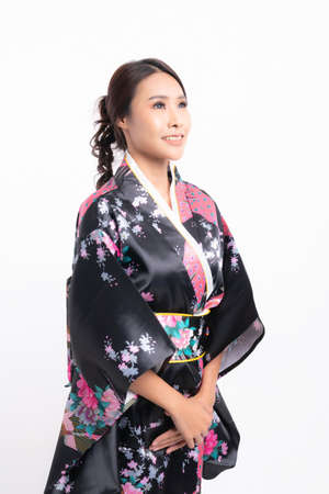 Beautiful attractive asian woman wearing traditional japanese kimono isolated on white background
