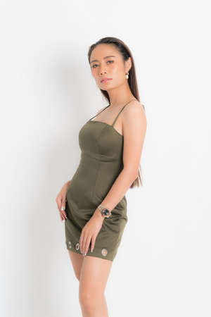 Fashion style catalog casual clothing for party sexy beautiful woman black long hair natural make up wear green dress costume perfect body shape suit at studio shoot on white background and shadow.