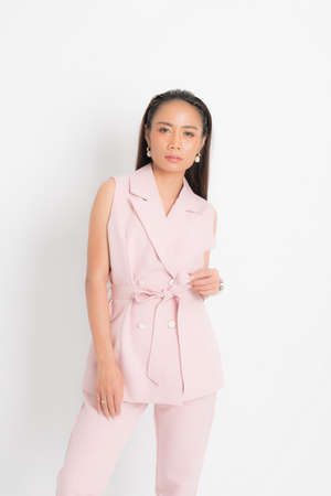 Fashion style catalog clothing for business woman black long hair natural make up wear pink suit costume perfect body shape suit at studio shoot on white background and shadow.