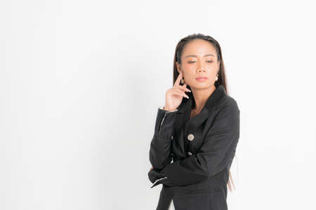 Fashion style catalog clothing for business woman black long hair natural make up wear black suit costume perfect body shape suit at studio shoot on white background and shadow.