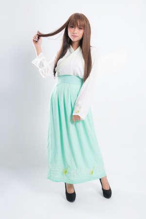 Korean woman wearing traditional korean dress on white background in studio. Beautiful Korea culture. Zdjęcie Seryjne