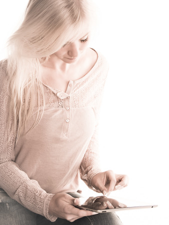 Soft image of young woman using a tablet