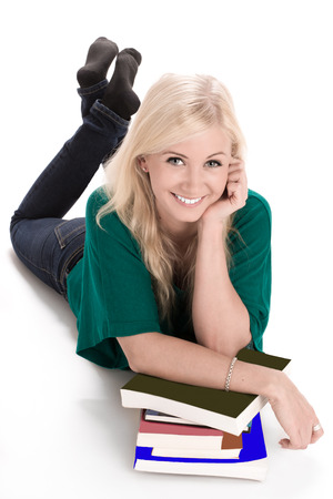 blonde females: Young smiling woman lying with book on the floor