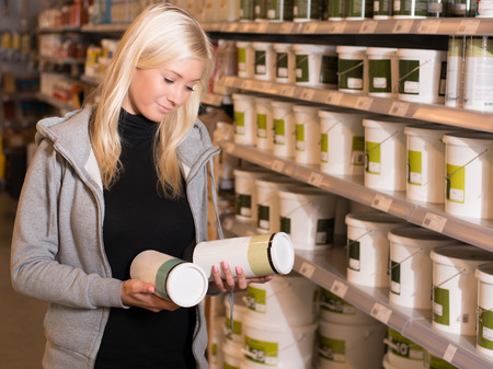 pricetag: Woman looking at products in hardware store