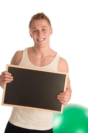 fitnesscenter: Personal trainer holding blackboard