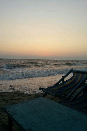 beside: chair beside the beach