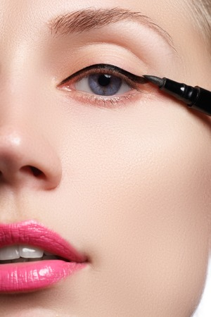 eye liner: Make-up beauty with brush eye liner on pretty woman face Stock Photo