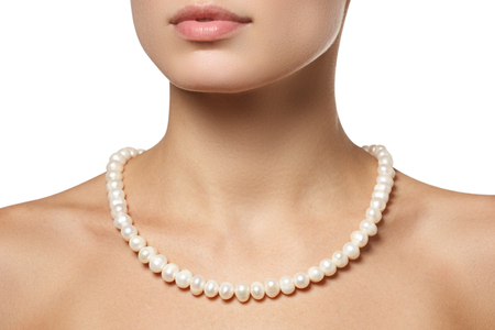 Beautiful fashion pearls necklace on the neck. Jewellery and bijouterie Standard-Bild