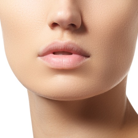 Perfect lips. Sexy girl mouth close-up. Beauty young woman. Natural full lips Standard-Bild