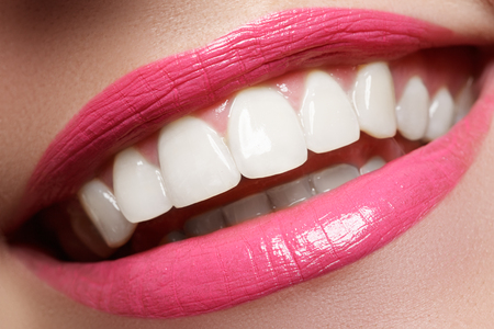 Woman smile. Teeth whitening. Dental care. Beauty concept
