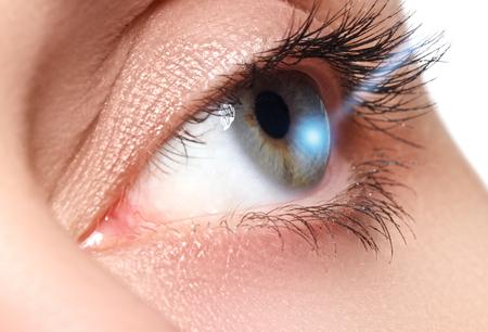 shinning: Laser vision correction. Womans eye. Human eye. Woman eye with laser correction. Eyesight concept