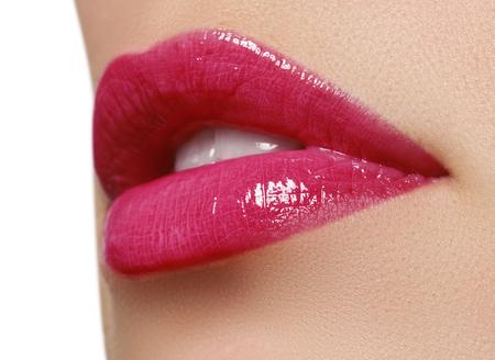 wet lips: Sexy pink wet lip makeup. Close-up of beautiful full lips. Glossy Lips. Lip Makeup.Beautiful Make-up.Sensual mouth. lipstick or Lipgloss.Professional Facial Makeup closeup
