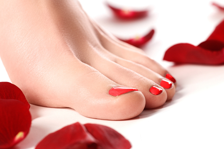 footcare: Healthy womans legs. Legs isolated on white. Beautiful woman legs. Depilation. Epilation. Pedicure. Soft skin