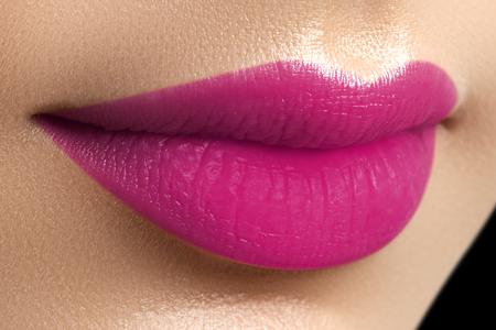 Perfect fuchsia lips. Sexy girl mouth close up. Beauty young woman smile. Fuchsia plump full Lips. Lips augmentation. Close up detail. Bright full lips