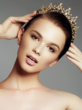 prom queen: Fashion gorgeous woman in diamond crown, beauty contest winner. Luxury girl with bright makeup, Elegant fashionable lady in studio, vogue style female. Fashion portrait of beautiful woman with jewelry Stock Photo