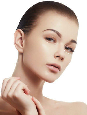 Beauty woman face portrait. Beautiful spa model girl with perfect fresh clean skin. Brunette female smiling. Youth and skin care concept. Over white background