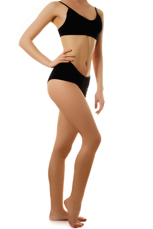 Sexy body of a beautiful woman. Beautiful woman body. Perfect shining skin for summer. Slim tanned womans body. Isolated over white background. Beautiful sexy female slim tanned body Stock Photo