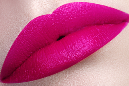 Beautiful full pink lips. Pink lipstick. Gloss lips. Make-up Cosmetics