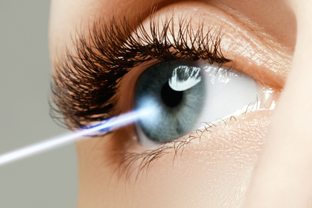 Laser vision correction. Woman's eye. Human eye. Woman eye with laser correction. Eyesight concept. Future technology, medicine and vision concept