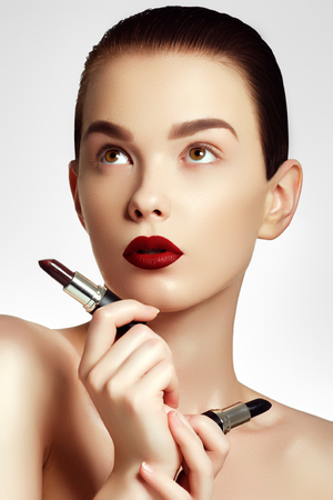 Sexy red lips. Beautiful lip makeup. Sensual Open Mouth with. Lipstick and lip gloss. Fashion make up