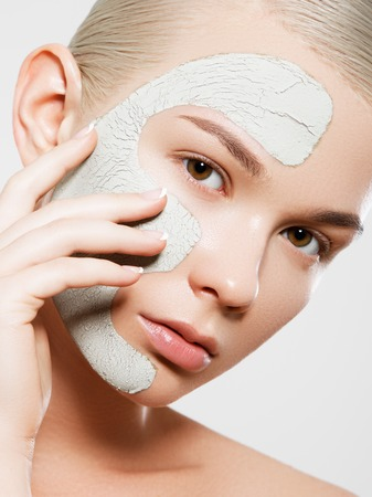 Skin And Body Care. Closeup Of Beautiful Sexy Woman With Cosmetic Clay Mask On Skin. Portrait Of Healthy Young Female With Fresh Natural Makeup. Spa Cosmetics Stock Photo