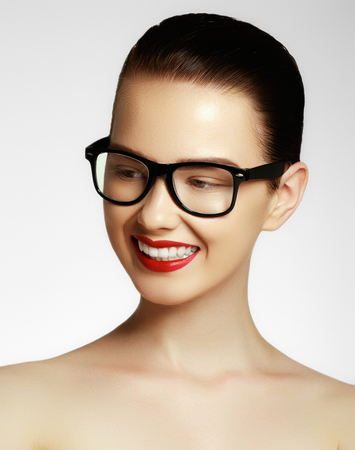 Beauty sexy fashion model girl wearing glasses, isolated on white background. Beautiful young brunette woman with trendy accessories. Fashion model in glasses. Fashion and accessories Stock Photo