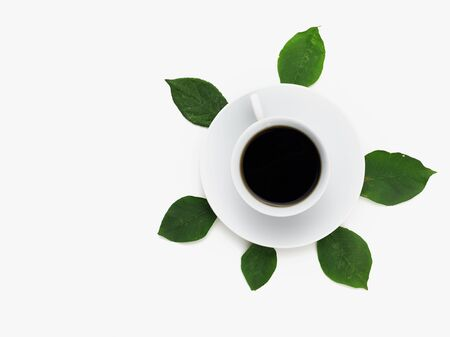 Coffee cup with leaves. Flat lay. Nature concept.
