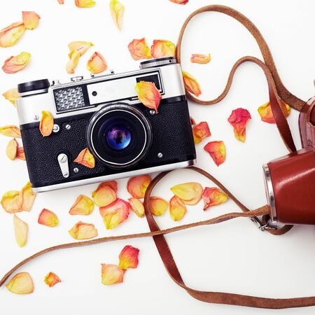 Flat lay. Top view. Old film camera. White background close-up. Vintage photo