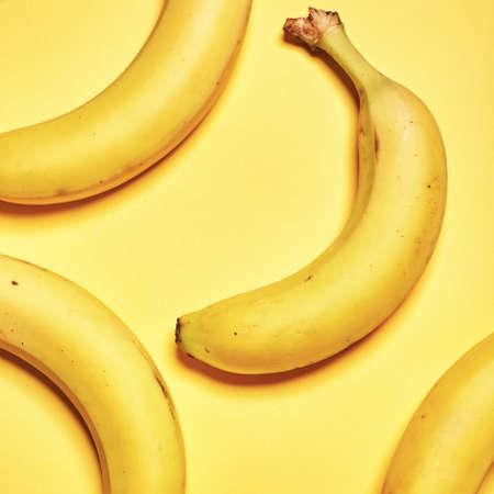 Banana on yellow background. Top view. Flat lay Standard-Bild