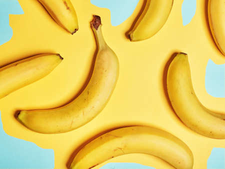Bananas on an abstract yellow background. Flat lay. Top view Standard-Bild